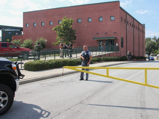 A law enforcement officer stands at Townville Elementary School on Sept. 28 after responding to a shooting.