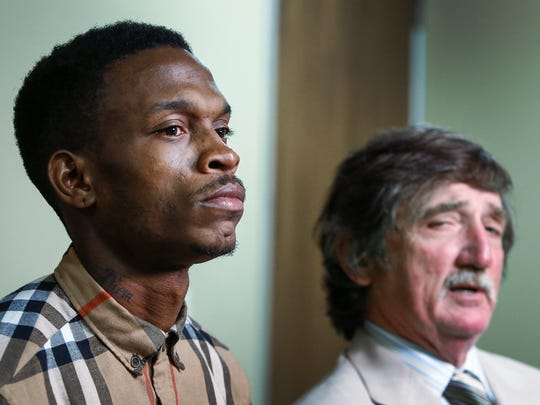 Former University of Memphis and White Station High School basketball standout Joe Jackson (left) stands by as his attorney Leslie Ballin (right) talks with the media after his first court appearance for an arrest Wednesday on felony drug and gun charges.