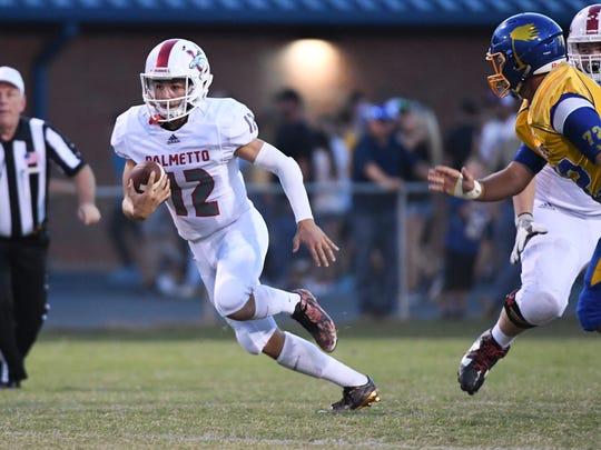 Palmetto sophomore Blair Garner runs near Wren junior Carter Vest during the first quarter at Wren High School in Piedmont on Friday.