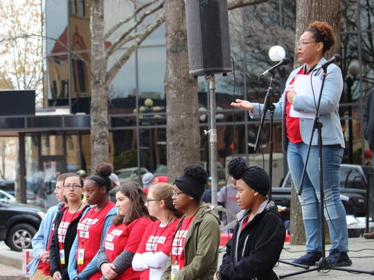 Tonya Winbush speaks behind a group of students at the March for Our Lives rally in downtown Anderson on Saturday. More than 100 people took part in the event calling for an end to gun violence and school shootings.