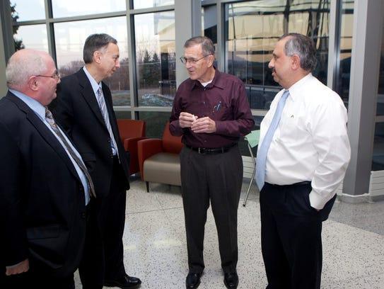 Harry Boyer (center) is the founder of Innovation Associates