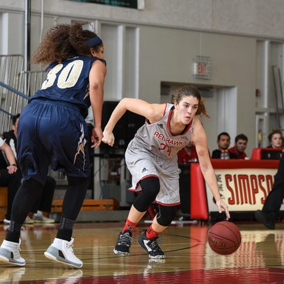 Simpson's Esther Wofford, right, controls the ball