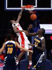 Rondae Hollis-Jefferson dunks against Mamadou Ndiaye of UC Irvine on Nov. 19, 2014, at McKale Center in Tucson.