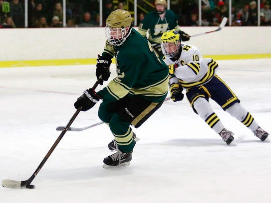 Howell's Dominic Rossi carries the puck up the ice