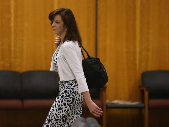 Laura Rideout leaves court after the first day of closing