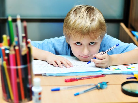 This innocent child doesn't yet know the world of pain he'll live in with that biro!