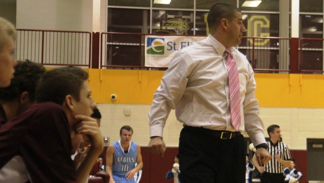 Cooper head coach Tim Sullivan watches the action in this file photo of Cooper vs. Boone County boys basketball Jan. 22, 2015.