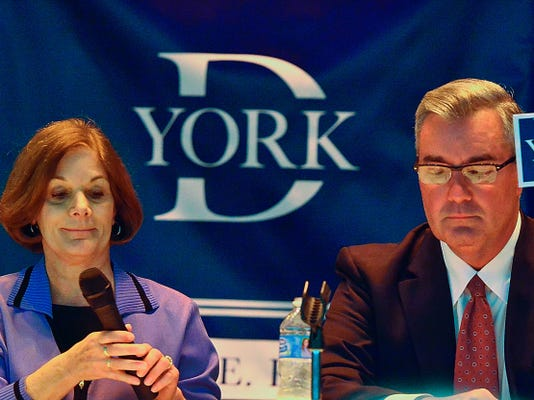 Incumbent Chris Reilly (R), holds up his rebuttal card after Susan Byrnes questioned the amount of time he spends working as a commissioner during the York Dispatch/YCEA York County Commissioners debate, Tuesday October 13, 2015 at the York Jewish Community Center.   John A. Pavoncello - jpavoncello@yorkdispatch.com