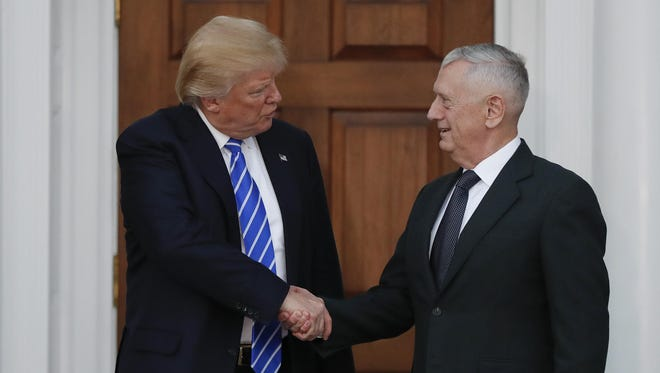 President-elect Donald Trump shakes hands with retired Marine Corps Gen. James Mattis at Trump National Golf Club Bedminster clubhouse in Bedminster, N.J.