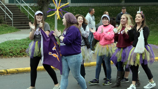 Wearing purple and gold tutus, members of the Delta Phi Epsilon, an international sorority on campus, were among University of Wisconsin-Stevens Point students in the 2016 Homecoming parade on Oct. 15. It was one of several events that brought thousands of alumni and community members to campus.