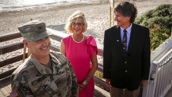 From left, Col. Andrew Kelly, commander and district engineer of the U.S. Army Corps of Engineers; Mayor Gail Coniglio; and Tim Murphy, deputy district engineer for programs and project management in the Corps' Jacksonville District announce Tuesday that Midtown Beach and the surrounding shore will be replenished with sand beginning in the first week of March.