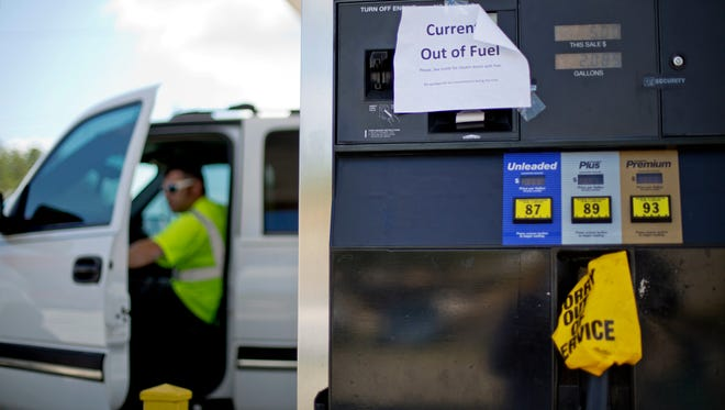 """A sign informs customers of a gas outage at a station in Smyrna, Ga., Monday, Sept. 19, 2016. Gas prices spiked and drivers found """"out of service"""" bags covering pumps as the gas shortage in the South rolled into the work week."""