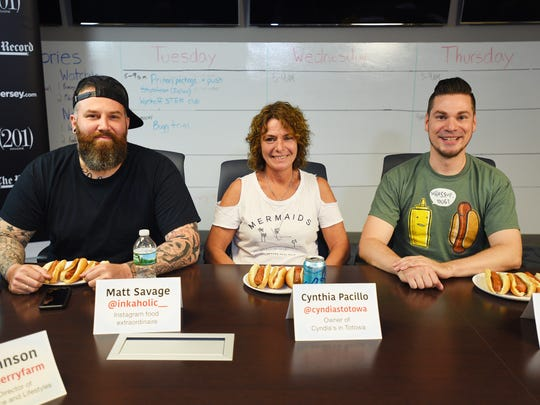 Hot dog lovers and enthusiasts Matt Savage of Garfield,   Cynthia Cynthia Pacillo of Roseland, owner of Cyndias' in Totowa and Teddy Gibbs of Woodland Park, pose for photos during the hot dog tasting at The Record in Woodland Park on June 5th, 2017.