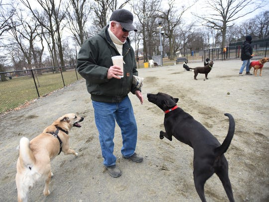 Teaneck resident Steve McGivney interacts with his dog Murphy, right, at Phelps Park in Teaneck on March 20, 2018.