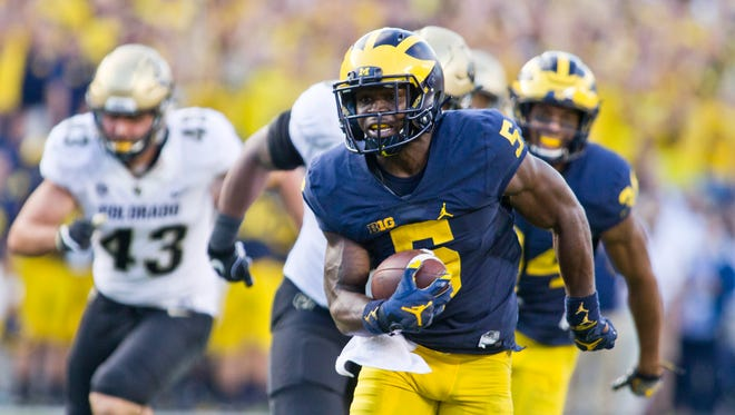 Jabrill Peppers returns a punt for a touchdown in the fourth quarter against Colorado at Michigan Stadium in Ann Arbor on Sept. 17, 2016.