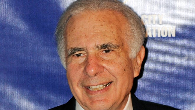 Financier Carl Icahn poses for photos upon arriving for the 32nd annual New York City Police Foundation Gala in New York.