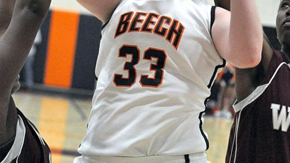 Beech senior Falon Baker goes between two West Creek defenders for a layup (and foul) during the first quarter of Friday's Region 5-AAA quarterfinals contest. Baker scored a game-high 33 in Beech's 60-41 win.