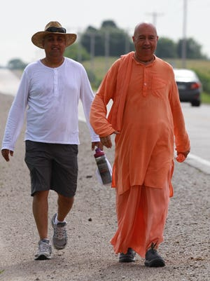 Bhaktmimarga Swami, right, is walking across America to promote a healthier global lifestyle, a strong spiritual foundation and a simple meditative life. His companion, left, is Rajasuya Dasa, the support person for the week.