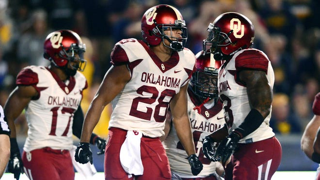 Oklahoma running back Alex Ross (28) and the Sooners are the No. 3 seed in the latest Football Four Playoff Projection.