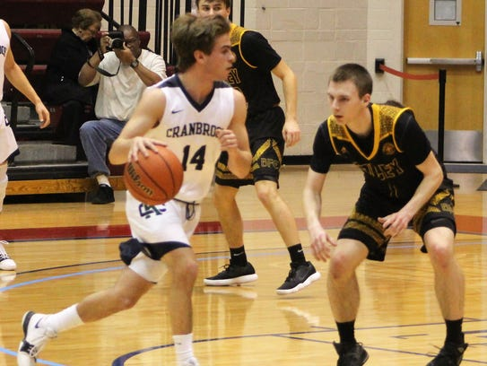 Junior guard Alex Finney (14) netted a key third-quarter four-point play which allowed Cranbrook Kingswood to maintain its lead against Bishop Foley on Sunday at Calihan Hall.