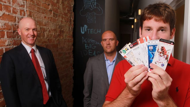 Alex Burkhart (right), founder/CEO of Tixers, with Andrew D. Sathe (left) and Brad Zapp, co-fund managers at Up Tech, a startup business accelerator in Covington.