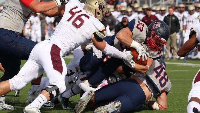 Shippensburg's Cole Chiappialle forces his way across the goal line for a Red Raider touchdown against Kutztown on Saturday, Oct. 29, 2016 at Seth Grove Stadium. Shippensburg lost to the Golden Bears 24-21 in double overtime.