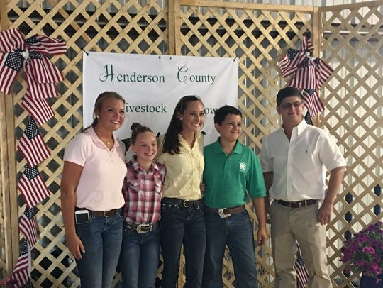 Cattle show participants were, from left: Riley Mabe,