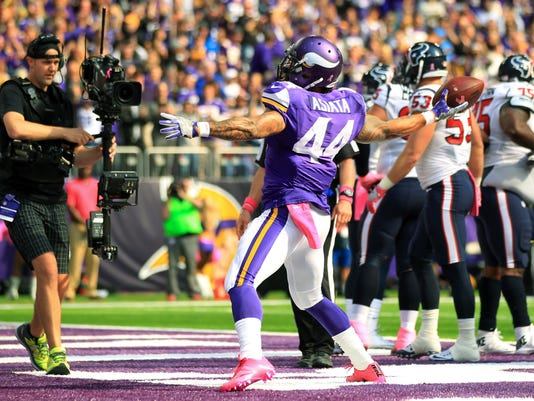 Minnesota Vikings running back Matt Asiata celebrates after scoring on a 1-yard touchdown run during the first half of an NFL football game against the Houston Texans, Sunday, Oct. 9, 2016, in Minneapolis. The Vikings won 31-13. (AP Photo/Andy Clayton-King)