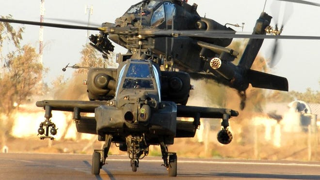 The Department of Justice has accused four men of stealing $100 million worth of information from Microsoft Corp. and simulator software used to train Apache attack helicopter pilots.