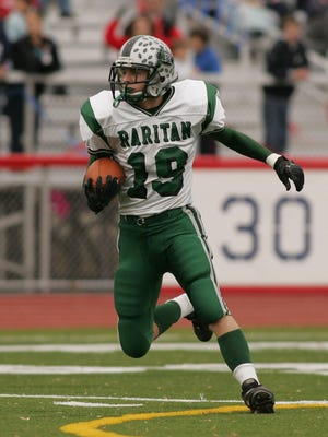Raritan's William Kvalheim turns to run after intercepting a pass against Governor Livingston in their NJSIAA Central Jersey Group II semifinal on Nov. 18, 2006.