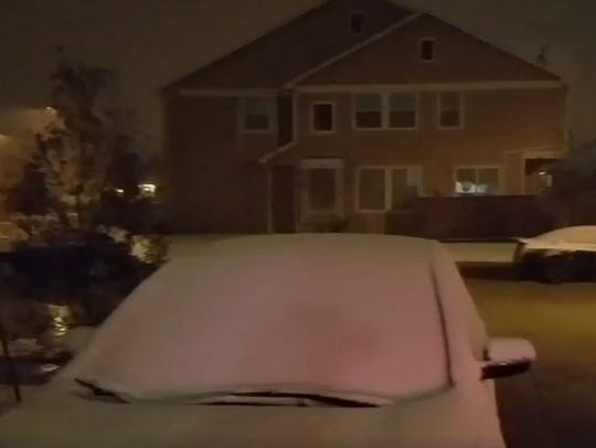 Snow blankets cars in the Houston suburb of Richmond,