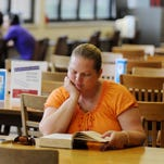 William Carey University psychology student Angela Pounders reads a psychology book Monday at the Dumas L. Smith I.E. Rouse Library during the first day of classes.