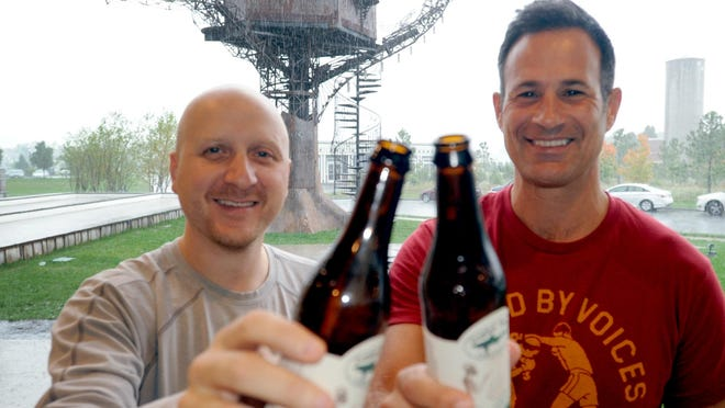 Sam Calagione (right), founder of Dogfish Head Craft Brewery, shares a toast with CEO Nick Benz at the company's Milton brewery in 2014.