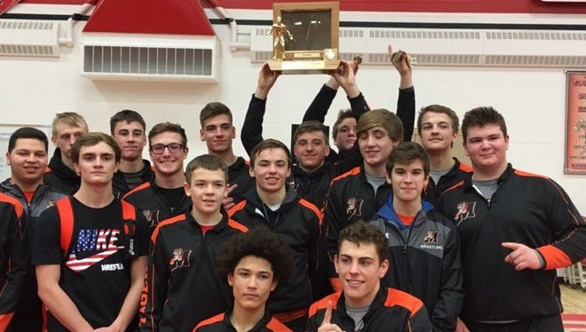 Members of the Marshfield wrestling team pose with the Wisconsin Valley Conference trophy Saturda at Wausau East after winning the championship for the second straight year