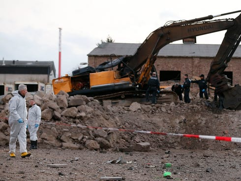 Police forces examine the scene of a World War II bomb explosion in Euskirchen, Germany, on Jan. 3, 2014.