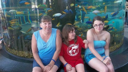Marilyn Rogers, seen here with her daughters, will use the money raised to help with medical expenses.