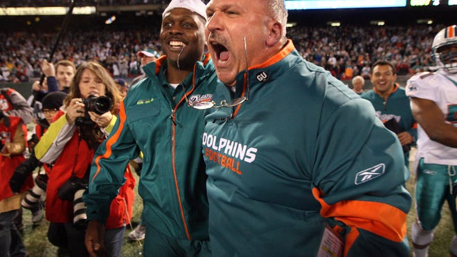 Former Dolphins head coach Tony Sparano celebrates the Dolphins defeating the Jets 24-17 to win the AFC East Title. Miami has a chance to repeat the feat for the first time since 2008.