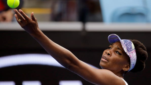 United States' Venus Williams serves to China's Duan Yingying during their third round match at the Australian Open tennis championships in Melbourne, Australia, Friday, Jan. 20, 2017. (AP Photo/Aaron Favila)