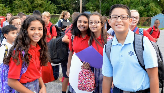 (From left) Bella Martinez, Shreya Retish, Oliva Matias, Addison Vurganov and Dominic Capelli were ready to start their first day of sixth grade at Bishop Schad Regional School in Vineland.