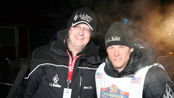Jim Keller (left) celebrates with musher Dallas Seavey last March after Seavey won the Iditarod Trail Sled Dog Race for the second time.