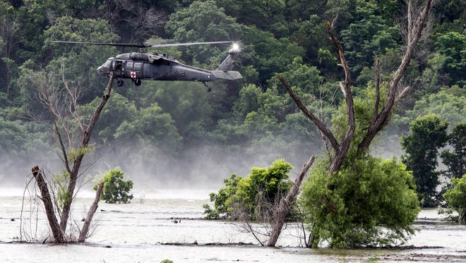 Army helicopters hover above Lake Belton Friday, June 3, 2016, searching for four missing soldiers from U.S Army's Fort Hood that were swept away in a low water crossing during training when the Army vehicle they were in was swept away on Thursday.