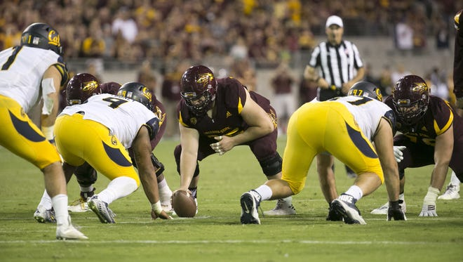 ASU center A.J. McCollum gets ready to snap the ball during the fourth quarter at Sun Devil Stadium in Tempe on Saturday, September 24, 2016. ASU won the game 51-41.