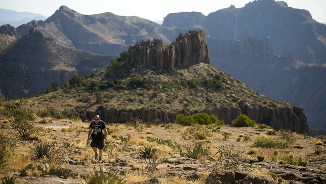 Blain Askew of Phoenix, hikes along the top of the Flatiron in the Superstition Mountains in the Superstition Wilderness Area outside of Apache Junction on November 16, 2017. The route begins long the Siphon Draw Trail in the Lost Dutchman State Park and climbs 3000 vertical feet to the top of the Flatiron.