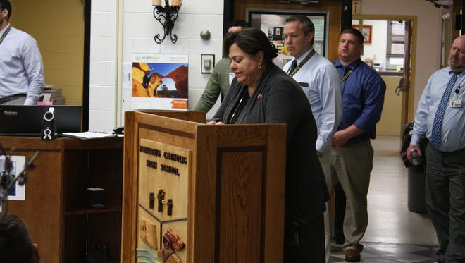 Paramus Catholic President Stephanie Macaluso announces the hiring of John Whitehead at an assembly in the Paramus Catholic library Wednesday.
