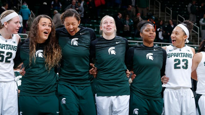 From left, MSU women's basketball players Becca Mills, Jasmine Hines, Madison Williams, Kelsey Kuipers, Branndais Agee and Aerial Powers celebrate following their win over Illinois on Thursday in East Lansing. Kuipers, a former volleyball player and high jumper, joined the women's basketball team due to a number of injuries, including ones to Hines, Williams and Agee.