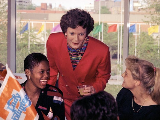 Lady Vols coach Pat Summitt laughs with players Nikki McCray, left, and Michelle Marciniak during a reception honoring the team at the Knoxville Museum of Art on April 19, 1995. (Heather Stone/Knoxville News Sentinel)