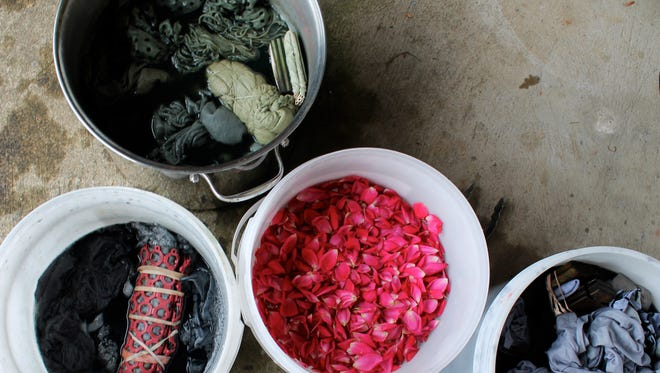 A natural dye bath, top left, made from pomegranate rinds, and natural dyes, bottom, made from rose petals and iron.