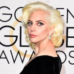 """FILE - In this March 2, 2014 file photo, Lady Gaga arrives at the Oscars in Los Angeles. Lady Gaga, the Weeknd and Sam Smith will perform at the Academy Awards on Feb. 28, 2016. Gaga's """"Til It Happens to You,"""" the song she wrote with Diane Warren for the sexual assault documentary, """"The Hunting Ground,"""" was nominated for an Oscar for best original song. (Photo by Jordan Strauss/Invision/AP, File)"""