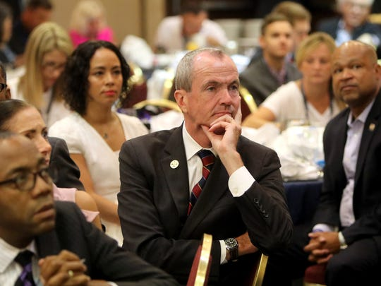 Democratic gubernatorial candidate Phil Murphy listens to speakers at the Airport Rennaissance Hotel in Tinicum Township, PA, during the Democratic National Convention NJ Delegates breakfast meeting Monday, July 25, 2016.