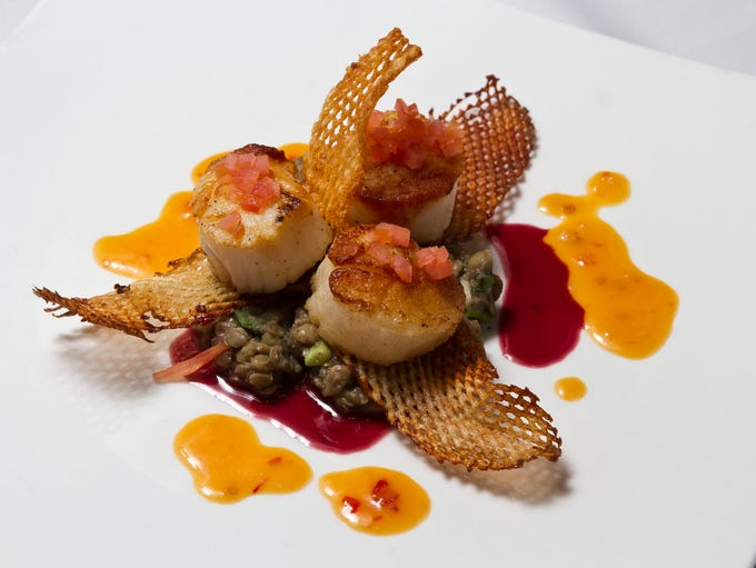 Seared scallops with herbed lentils, cabernet reduction